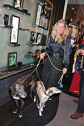 PHILIPPA HOLLAND and her dogs Elfie & Zola at a private view of an exhibition 'Outside in Chelsea' held at Annoushka, 41 Cadogan Gardens, London SW3 on 2nd October 2012.