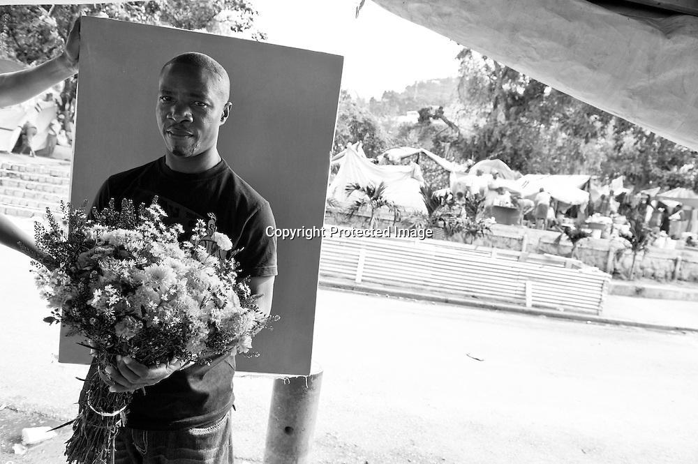 Delinois Flerisier, 40, sells flowers across from a a tent camp that sprang up in a city plaza in Petion Ville. His house is damaged, and he lives in his neighborhood under a few tarps. He says that no one bought flowers for the people killed in the earthquake, as they usually would to honor the dead.