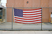 American Flag on a barbed wire fence