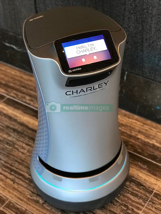 """Meet Charley — a dancing robot 'butler' who delivers mini-bar item directly to your door at a new super luxury apartment tower in Los Angeles. Charley, who is based in the lobby at the opulent 40-storey Ten Thousand complex, can deliver anything from a bottle of water to champagne and chocolates to residents' doors. A spokesman for Ten Thousand explained: """"The resident makes a request and Charley enters the elevator and brings it to your door. """"Once the item is retrieved, Charley does a little dance and proceeds back down to the lobby."""" Charley is one of a host of super high-end service on offer at Ten Thousand, which is located on the border of Beverly Hills and Century City and opened last year. The property, designed by Handel Architects, is being billed as the future of LA's real estate market as the city looks to build more high-rise residences, much like the New York aesthetic. The residential tower features 75,000 sq ft of amenities and hospitality services overseen by a house staff of 80, from a leading-edge fitness and wellness center, indoor and outdoor pools, indoor and outdoor theaters, performance coaches, nutritionists and in-house car service, Residents can even book a room with an exam table to have facials and massages, or even call in their own medical technician — so if you need a few botox jabs or your fillers updating, you have the luxury of being able to do so on the site of your residence. Such luxury comes with a hefty price tag of course — two and three-bedroom apartments, complete with 10ft-high ceilings and panoramic views through floor-to-ceiling glass windows range anywhere from $9,000 to $25,000 per month while the jewel in the crown is the penthouse at $65,000 per month. 14 Jan 2018 Pictured: Ten Thousand is a new high-rise, luxury development in Los Angeles, California. Local caption: Charley the robot butler. Photo credit: Ten Thousand/ MEGA TheMegaAgency.com +1 888 505 6342"""