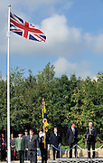© licensed to London News Pictures. CARTERTON, UK.  01/09/11. The flag flies above the memorial. A ceremony, attended by British Prime Minister David Cameron,  takes place at The Memorial Garden at Norton Way in Carterton, Oxfordshire today (01 Sept 2011). The Garden will become the focal point during the repatriation of UK service personnel from RAF Brize Norton. The Union Flag that used to fly at repatriations in Wooton Bassett was handed over and was blessed. . Mandatory Credit Stephen Simpson/LNP