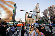 Busy crossing at Gwanghwamun. Kyobo Building (l.)
