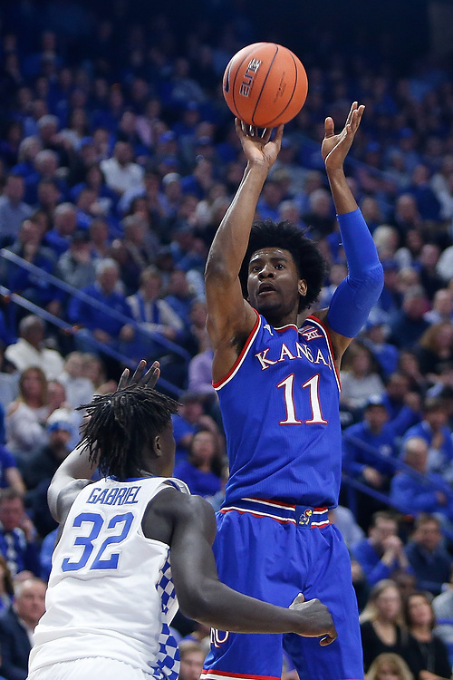Kansas Jayhawks guard Josh Jackson shoots a jumper over Kentucky Wildcats forward Wenyen Gabriel on Saturday January 28, 2017 at Rupp Arena in Lexington, Ky. Photo by Michael Reaves | Staff