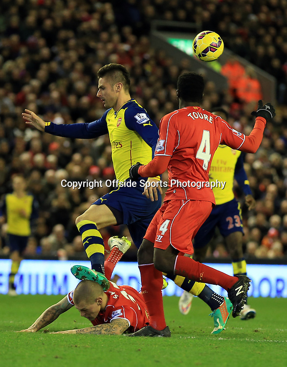 21 December 2014 - Barclays Premier League - Liverpool v Arsenal - Olivier Giroud of Arsenal stands on the head of Martin Skrtel of Liverpool - Photo: Marc Atkins / Offside.