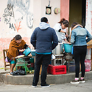 Women selling Mexican street food on a corner in San Christobal