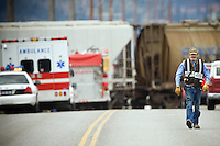 JEROME A. POLLOS/Press..Maynard Nisbet walks away from a train accident last year near Rathdrum where he was one of the first people to arrive and helped divert traffic so rescue workers could clear the scene. Nisbet, who has volunteered for a number of emergency services over the last 30 years, now needs assistance of his own after undergoing emergency heart surgery last month.