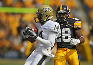 September 17, 2011: Pittsburgh Panthers kick returner Ronald Jones (14) pulls in a kick as Iowa Hawkeyes defensive back Shaun Prater (28) closes in during the first half of the game between the Iowa Hawkeyes and the Pittsburgh Panthers at Kinnick Stadium in Iowa City, Iowa on Saturday, September 17, 2011. Iowa defeated Pittsburgh 31-27.
