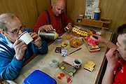 Icelandic cod fisherman Karol Karelsson (middle) makes a cup of coffee in the galley of a fishing boat near the small port of Sandgerdi on the western side of Reykjanes peninsula, Iceland. (Karol Karelsson is featured in the book What I Eat: Around the World in 80 Diets.) MODEL RELEASED.