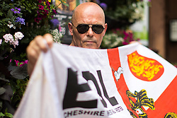 "© Licensed to London News Pictures . 24/06/2017. London, UK. EDL supporters on Whitehall . The English Defence League ( EDL ) hold a March on Parliament , from Charing Cross to Victoria Embankment , opposed by  a counter demonstration by Unite Against Fascism . Scotland Yard said it was using public order laws to restrict the marches ""due to concerns of serious public disorder, and disruption to the community"" following terrorist attacks in Manchester , Westminster and Finsbury Park and the Grenfell Tower fire  . Photo credit: Joel Goodman/LNP"