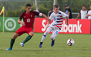 Team USA midfielder Evan Rotundo (10) and Portugal midfielder Marco Cruz (10) fight for possession of the ball during a CONCACAF boys under-15 championship soccer game, Saturday, August 10, 2019, in Bradenton, Fla. Portugal defeated Team USA 3-0 and advanced to the finals against Slovenia. (Kim Hukari/Image of Sport)