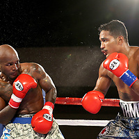 Yamaguchi Falcao (R) fights against Taronze Washington during a Fire Fist Boxing Promotions boxing match at the A La Carte Pavilion on Saturday, August 12 , 2017 in Tampa, Florida.  (Alex Menendez via AP)