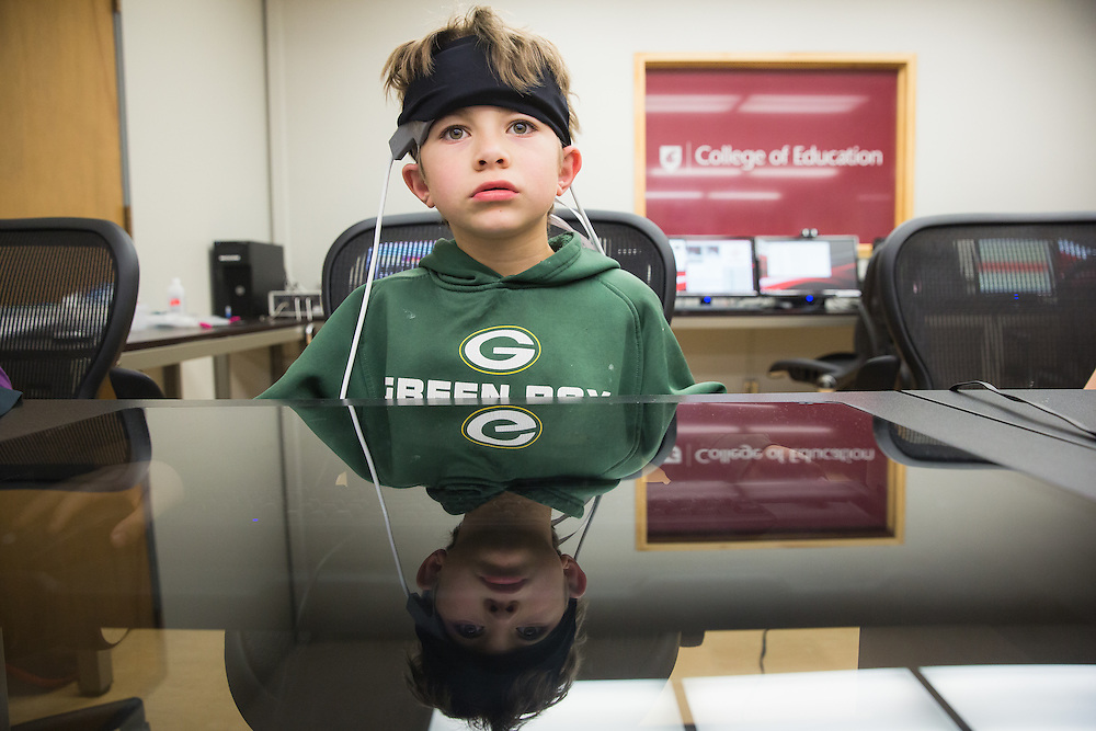 Ramsey Itani, 7, a first-grade student at Sunnyside Elementary in Pullman, Wash., wears Functional Near Infrared Spectroscopy device while listening to his teacher's instructions during a field trip to the Washington State University neurocognition sciene lab Monday, Feb. 22, 2016.
