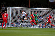 Scott Flinders saves from Christopher Routis during the Capital One Cup match between York City and Bradford City at Bootham Crescent, York, England on 11 August 2015. Photo by Simon Davies.