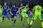 AFC Wimbledon midfielder Callum Reilly (33) battles for possession during the EFL Sky Bet League 1 match between AFC Wimbledon and Bolton Wanderers at the Cherry Red Records Stadium, Kingston, England on 7 March 2020.