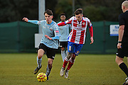 Dorking Wanderers James McShane attempts a tackle against Lewes FC Ronnie Conlon during the Ryman League - Div One South match between Dorking Wanderers and Lewes FC at Westhumble Playing Fields, Dorking, United Kingdom on 28 January 2017. Photo by Jon Bromley.