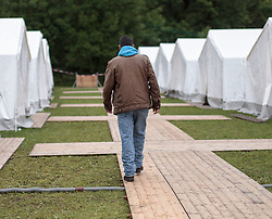 24.05.2015, Polizeidirektion, Salzburg, AUT, Zeltstadt fuer Fluechtlinge in Salzburg, im Bild ein Flüchtling spaziert zu seinem Zelt // a refugee in the tent city at the sports ground of the Police Directorate, Salzburg, Austria on 2015/05/24. EXPA Pictures © 2015, PhotoCredit: EXPA/ JFK