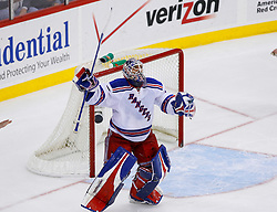 March 19, 2008; Newark, NJ, USA;  New York Rangers goalie Henrik Lundqvist (30) celebrates after stopping New Jersey Devils left wing Zach Parise (9) to win the game at the Prudential Center. The New York Rangers defeated the New Jersey Devils 2-1 in a shootout.