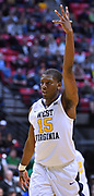 SAN DIEGO, CA - MARCH 18:  West Virginia Mountaineers forward Lamont West (15) celebrates after scoring on a layup against the Marshall Thundering Herd during a second round game of the Men's NCAA Basketball Tournament at Viejas Arena in San Diego, California. West Virginia won 94-71.  (Photo by Sam Wasson)