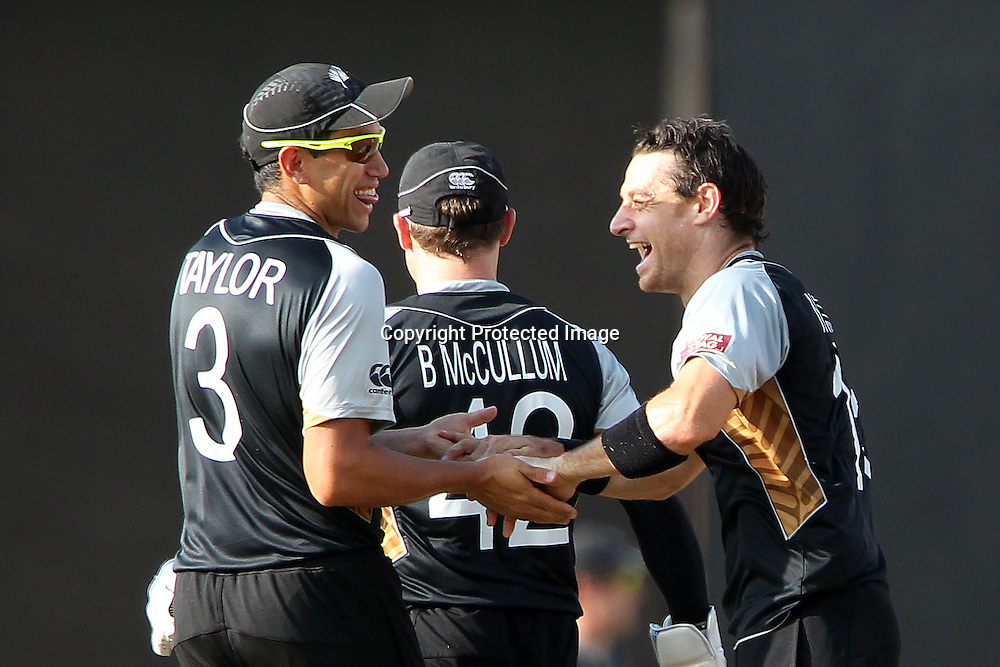 Nathan McCullum celebrates the wicket of Marlon Samuels of The West Indies with Brendon McCullum and Ross Taylor (Captain) during the ICC World Twenty20 Super Eights match between The West Indies and New Zealand held at the  Pallekele Stadium in Kandy, Sri Lanka on the 1st October 2012<br /> <br /> Photo by Ron Gaunt/SPORTZPICS/PHOTOSPORT
