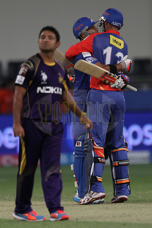 Jean-Paul Duminy of the Delhi Daredevils celebrates the win with Nathan Coulter-Nile of the Delhi Daredevils during match 6 of the Pepsi Indian Premier League Season 7 between the Kolkata Knight Riders and the Delhi Daredevils held at the Dubai International Cricket Stadium, Dubai, United Arab Emirates on the 19th April 2014<br /> <br /> Photo by Ron Gaunt  / IPL / SPORTZPICS