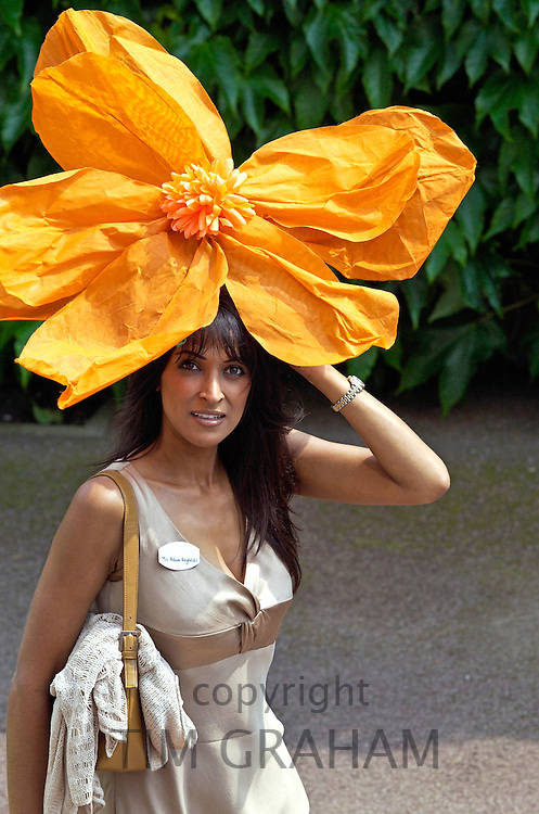 One of the ladies at Royal Ascot wearing a striking orange floral hat.  Although it is not Ladies Day everyone likes to dress for the occasion.