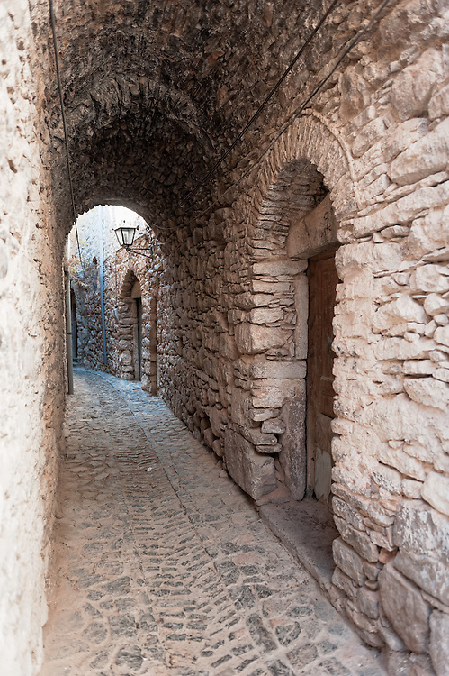 One of the narrow alleys in Mesta village in Chios island, Greece.