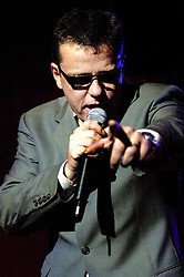 Suggs Madness vocalist at Sheffields Hallam FM Arena. The show was stopped for around 30 minutes after the first three songs, when over enthusiastic fans mannaged to throw beer over the mixing desk causing the sound system to fail. Staff at the Hallam FM Arena Came to the rescue with the hair dryer which was used to dry out soggy sound system and Madness went on to play the whole Show<br /> 11 December 2003<br /> <br /> image copyright Paul David Drabble