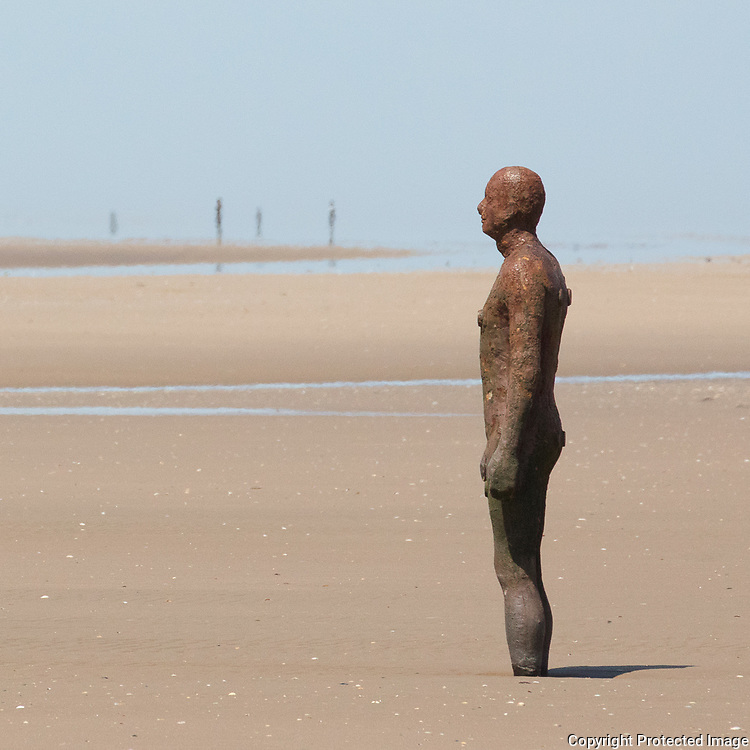 Another Place cast iron figure based on Antony Gormley's own body, Crosby Beach, Merseyside.