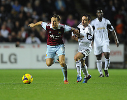 West Ham United's Mark Noble battles for the ball with Swansea City's Leon Britton  - Photo mandatory by-line: Joe Meredith/JMP - Tel: Mobile: 07966 386802 27/10/2013 - SPORT - FOOTBALL - Liberty Stadium - Swansea - Swansea City v West Ham United - Barclays Premier League