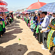 A corridor of young people play catch at the New Year celebration in Phonsavan. Young Hmong men and women flock to the New Year festival in in Phonsavan in northeastern Laos. Hmong girls dress in brightly colored costumes and engage ball games of catch as part of a ritual traditionally designed to find husbands. The people of the region are predominantly of Hmong ethnicity.
