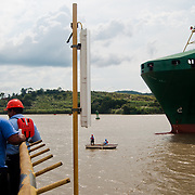 MIRAFLORES LOCKS - THE PANAMA CANAL / ESCLUSAS DE MIRAFLORES - EL CANAL DE PANAMA<br /> Photography by Aaron Sosa<br /> Panama City, Panama 2012<br /> (Copyright © Aaron Sosa)<br /> <br /> The Panama Canal is an 77.1-kilometre (48 mi) ship canal in Panama that connects the Atlantic Ocean (via the Caribbean Sea) to the Pacific Ocean. The canal cuts across the Isthmus of Panama and is a key conduit for international maritime trade. There are locks at each end to lift ships up to Lake Gatun (26m (85ft) above sea-level) which was used to reduce the amount of work required for a sea-level connection. The current locks are 33.5m (110ft) wide although new larger ones are proposed.<br /> <br /> Work on the canal, which began in 1881, was completed in 1914, making it no longer necessary for ships to sail the lengthy Cape Horn route around the southernmost tip of South America (via the Drake Passage) or to navigate the dangerous waters of the Strait of Magellan. One of the largest and most difficult engineering projects ever undertaken, the Panama Canal shortcut made it possible for ships to travel between the Atlantic and Pacific Oceans in half the time previously required. The shorter, faster, safer route to the U.S. West Coast and to nations in and along the Pacific Ocean allowed those places to become more integrated with the world economy.