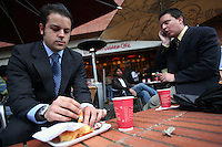 A man has a coffee and a snack at a Juan Valdez coffee shop in north Bogotá on Friday, May 4, 2007. (Photo/Scott Dalton)