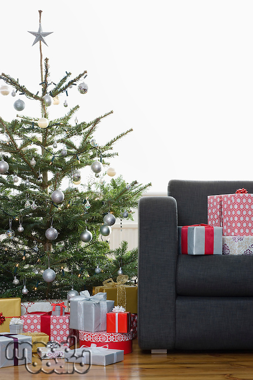 Christmas presents by tree and on armchair