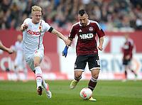 FUSSBALL   1. BUNDESLIGA  SAISON 2012/2013   8. Spieltag 1. FC Nuernberg - FC Augsburg       21.10.2012 Kevin Voigt (li, FC Augsburg) gegen Timo Gebhart (1 FC Nuernberg)