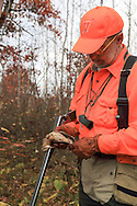 Upland hunter, Dennis LaBare, examining a woodcock taken during a northern Wisconsin hunt.