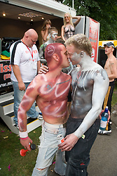 Two men in body paint kissing each other at Nottingham's 2005 Gay Pride Lesbian festival; held at the Arboretum,