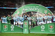 Vincent Kompany (4) of Manchester City lifts the Carabao Cup during the celebrations on the pitch after a 3-0 win over Arsenal during the EFL Cup Final match between Arsenal and Manchester City at Wembley Stadium, London, England on 25 February 2018. Picture by Graham Hunt.