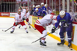 Mikolaj Lopuski of Poland vs Jan Drozg of Slovenia during Ice Hockey match between National Teams of Slovenia and Poland in Round #2 of 2018 IIHF Ice Hockey World Championship Division I Group A, on April 23, 2018 in Budapest, Hungary. Photo by David Balogh / Sportida
