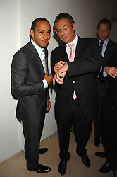Left to right, racing driver LEWIS HAMILTON and JEAN-CHRISTOPHE BABIN President and CEO of TAG at an evening with racing driver Lewis Hamilton held at The Hempel Hotel, 31-35 Craven Hill Gardens, London W2 on 4th July 2007.<br /><br />NON EXCLUSIVE - WORLD RIGHTS