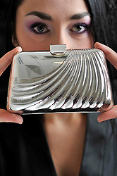 © Licensed to London News Pictures. 20/02/2013. London, UK. Sheffield silversmith Katey Felton is seen with her silver clutch bag inspired by the Duchess of Cambridge which goes on exhibition at Goldsmiths' Hall, London today (20/02/2013) as part of the ?Growing Talent? exhibition. The exhibition, focuses on jewellers and silversmiths who have been nurtured by the Goldsmiths' Company over the past decade, runs from 11 March to April 13 2013 at the Goldsmiths' Hall. Photo credit: Imagewise/LNP