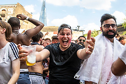 © Licensed to London News Pictures. 07/07/2018. London, UK. England fans celebrate after England score their second goal in the World Cup Quarter Final against Sweden as it is shown on the big screen at Flat Iron Square in London. Photo credit: Rob Pinney/LNP