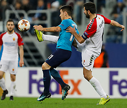November 23, 2017 - Saint Petersburg, Russia - Sebastian Driussi (C) of FC Zenit Saint Petersburg and Boban Grncharov of FK Vardar vie for the ball during the UEFA Europa League Group L match between FC Zenit St. Petersburg and FK Vardar at Saint Petersburg Stadium on November 23, 2017 in Saint Petersburg, Russia. (Credit Image: © Mike Kireev/NurPhoto via ZUMA Press)