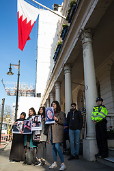 London, UK. 14th February, 2019. Activists from the Bahrain Institute for Rights and Democracy (BIRD) and Campaign Against the Arms Trade (CAAT) stand in solidarity outside the Bahrain Embassy to mark eight years since the Day of Rage in Bahrain, a movement for democracy and social justice which was crushed by the Bahraini regime with support from the military of Saudi Arabia. Speakers called for the release of political prisoners held in Bahrain and for the UK to stop licensing arms to Bahrain (over £100 million in licences have been granted since the uprising began in February 2011).