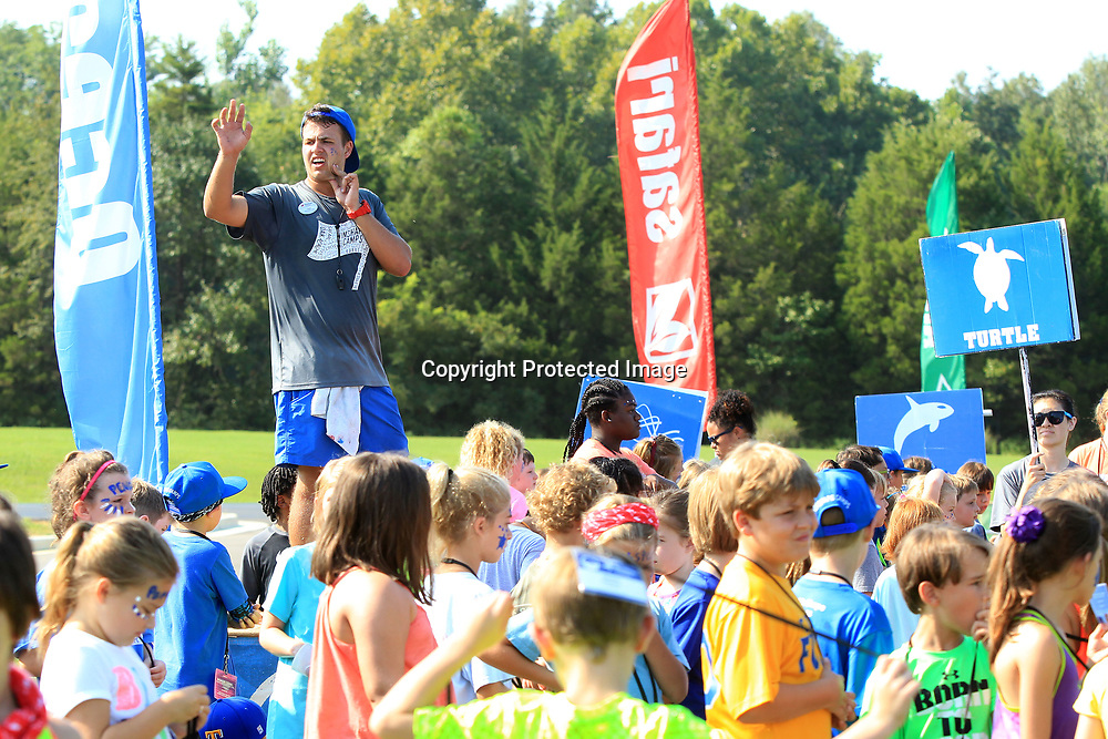 """Owen Ellis, a WinShape counselor, calls out for his group, the Tiger Sharks, to meet with him before they start """"Connectreation"""" time at WinShape Camp Wednesday morning at Harrisburg Baptist Church in Tupelo."""