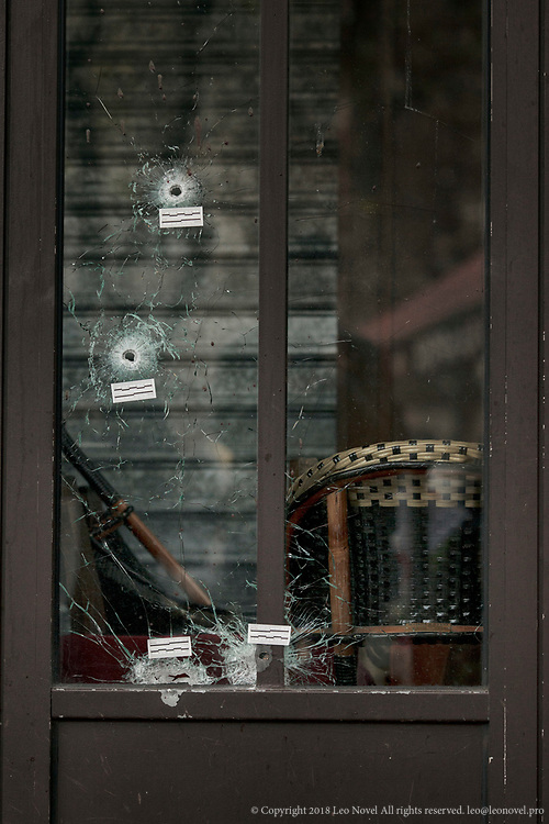 16  November  2015 – Paris, France Bullet holes remain intact on the front glass of a bar in central Paris where people were gunned down.  In a series of acts of violence, some 129 people were killing in shootings and suicide bombing. ISIL or islamic state claimed the responsibility.