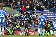 Brighton and Hove Albion forward Glenn Murray (17) battles for a header with Arsenal defender Shkodran Mustafi (20) during the Premier League match between Brighton and Hove Albion and Arsenal at the American Express Community Stadium, Brighton and Hove, England on 4 March 2018. Picture by Phil Duncan.