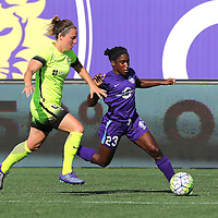 Orlando Pride forward Jasmyne Spencer (23) beats Seattle Reign FC defender Rachel Corsie (4) during a NWSL soccer match at Camping World Stadium on May 8, 2016 in Orlando, Florida. (Alex Menendez via AP)