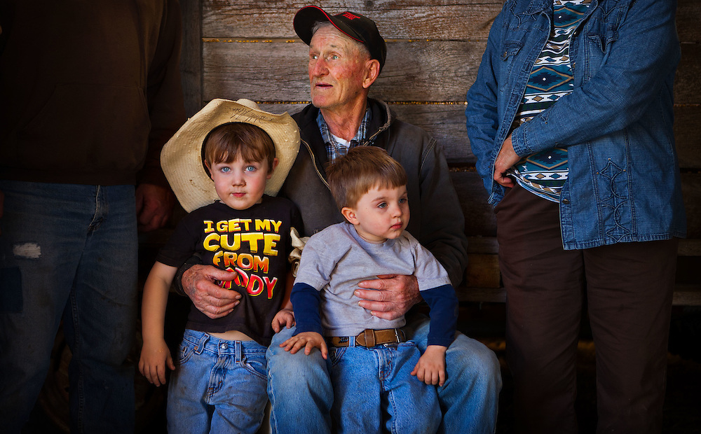 "Ben Burdick holds his great-grandsons, Trevor Burdick, 3, at left, and Mason Burdick, 2, before posing for a family picture after lunch at the Burdick Ranch south of Wood Lake, Neb. on Saturday, April 21, 2012. The Burdick family, now with four generations working the land, credit their branding success to neighbors and hire hands. ""We run a thousand cows,"" Ben Burdick said. ""If you didn't have help, you couldn't operate."" 