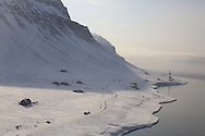 Aerial view in April of snow-covered mountains and coast near Longyearbyen; Svalbard, Norway.