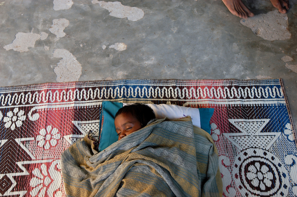A child displaced by the December 26, 2004 Tsunami that struck S.E. Asia sleeps at the Sakkoddai Catholic School..Sakkoddai, Point Pedro, Sri Lanka. 14/01/2005.Photo © J.B. Russell